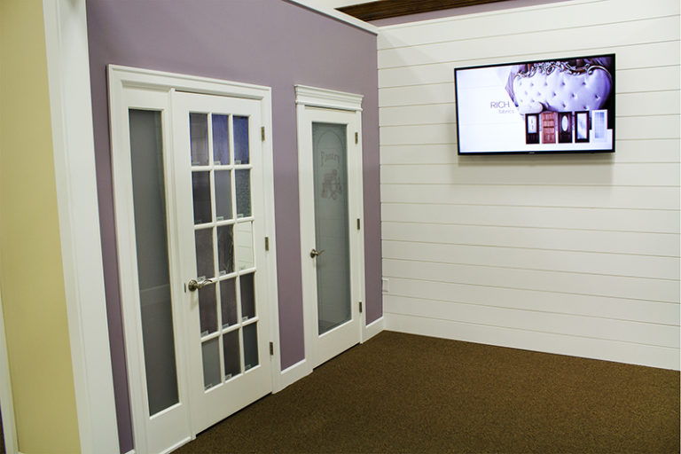white framed doors on a purple painted wall