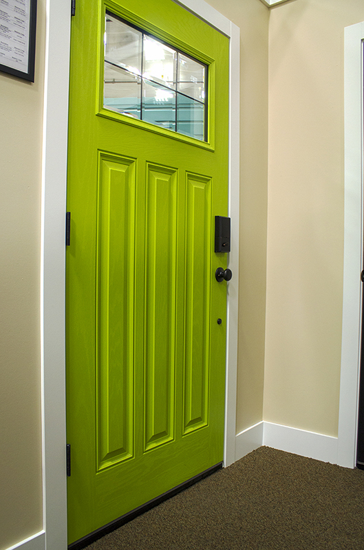 green door with one window at the top